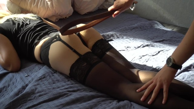 Girlfriends who spank Girlfriend in sexy stockings spanked with a belt