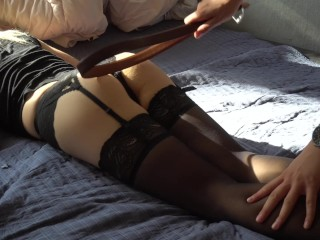 Girlfriend in sexy stockings spanked with a belt