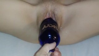 Wrecking her pussy with a bottle and brutal dildo.