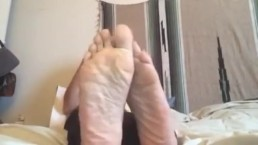 smelly feet on the bed