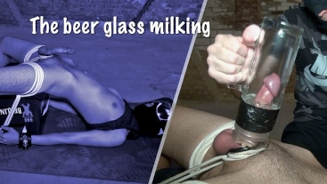 Twink getting milked into beer glass while bound to crate