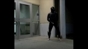 barefoot frogman cums inside a condom in front of hotel doors