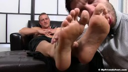 Attractive hunk relaxes while having armpits and feet licked