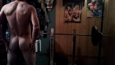 Hot tattooed muscular guy working out nude..