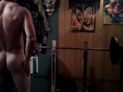 Amateur muscular guy working out in the nude..