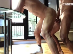 Caged jock locked in chastity eating ass in public