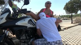 Blonde masturbates and pisses on a motorcycle.