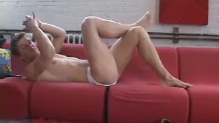 Handsome beyond belief Andre parades his body and feet solo