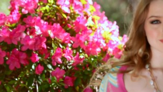 Holly Randall — Pale busty babe masturbates in beautiful garden