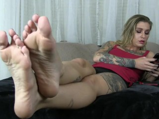 Kleio Valentien Ignores you while she plays on her phone she waves her feet