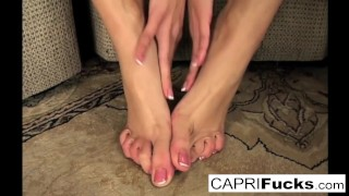 Capri not only plays with her wet pussy but also her sexy feet Asian shemale