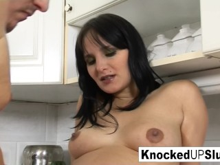 Pretty and pregnant babe gets fucked in the kitchen