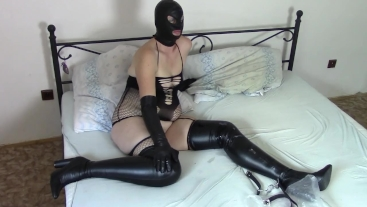 Angela in leather and fishnets (with slave's cum)