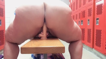 Fucking a dildo in the gym's locker room