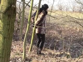 Outdoors handcuffed in fur coat