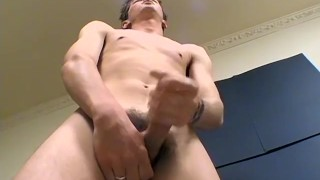 Cockteasing youngster Shane strokes his meat passionately