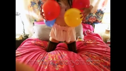 Sexy Brunette Blowing Balloons in Bed Wearing Thigh High Stockings FULLCLIP