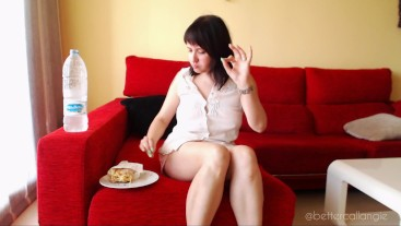 Burping and eating a Spanish omelette, crossed legs and revealing upskirt