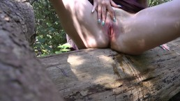 I spread my pussy wide open and piss from a log in the forest
