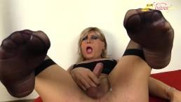 Blonde tgirl in black stockings masturbates with cumshot