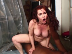 FUCKED AT WORK! THE REDHEAD WITH HUGE TITS GETS HER BLACK DELIVERY IN REAR
