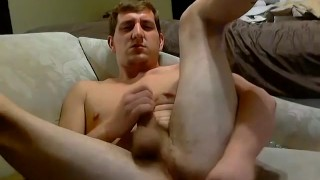 Gorgeous young Wyatt masturbates with a huge brown dildo
