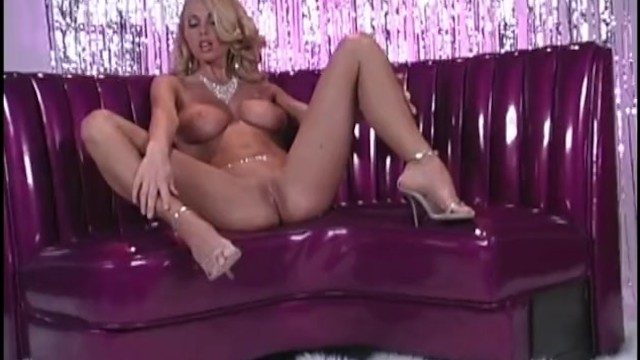 Sexy Striptease on the Purple Couch by Anita Dark