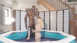 Fake tit blonde gets fucked by big black cock oiled up in a pool