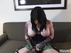 Busty goth tgirl tugs hard cock on the couch