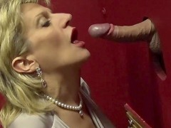 Busty British mature Lady Sonia visits a gloryhole