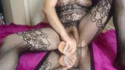 Slut in fishnets fucks herself with monster dildo
