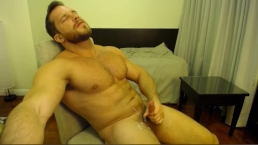 Sexy hunk cums all over his pubes