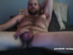 Daddy jerks his pierced prince albert cock while riding a dildo
