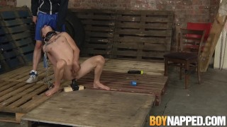 Chained gay slave shoves a giant dildo up his ass for master And gay