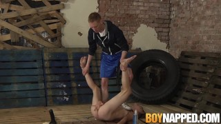 Chained gay slave shoves a giant dildo up his ass for master porno