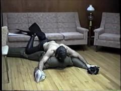 wearing neoprene pants, mask, gloves, fins, attacks dummy