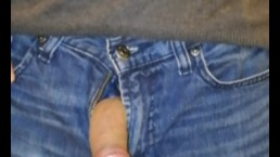 Uncircumsized cock taken out of jeans and stroked