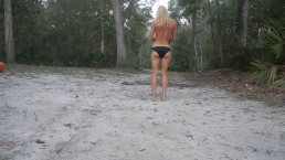 frisky blonde striptease outside in nature gets topless with nice ass
