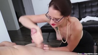 Sexy milf jerks off a cock