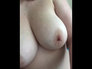 Horny girl plays with her huge tits