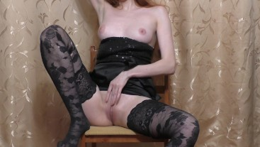 Slutty girl play with dildo on a chair