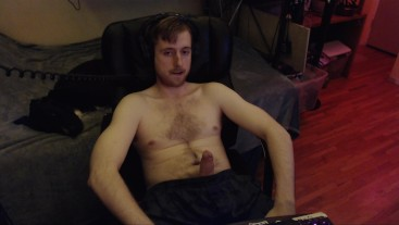 20 something cam model jerks off watching porn while audience watches him