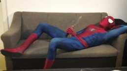 Horny Spiderman jerks off and cums massive load