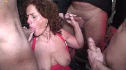 Big Tit Redhead MILF Sucks Three Big Dicks at the Same Time