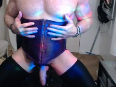 muscle man playing with tight corset