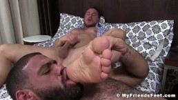 Business hunk tugging his dick while being feet worshiped