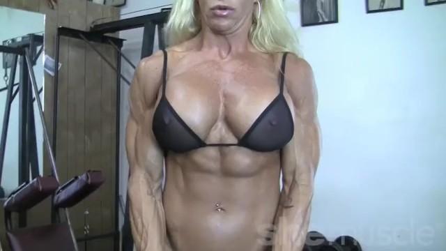 See thru tank top milfs Blonde female bodybuilder in see thru top works out hard