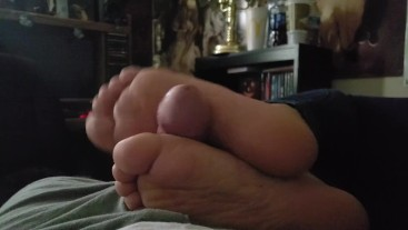Little Stepsister footjob while watching tv
