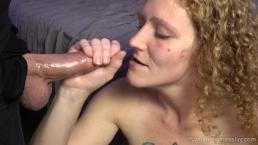 Redhead MILF Ivy sucking balls while stroking cock