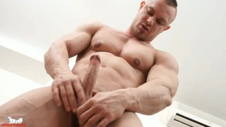 Zahn pulls his hard, uncut cock from his underwear